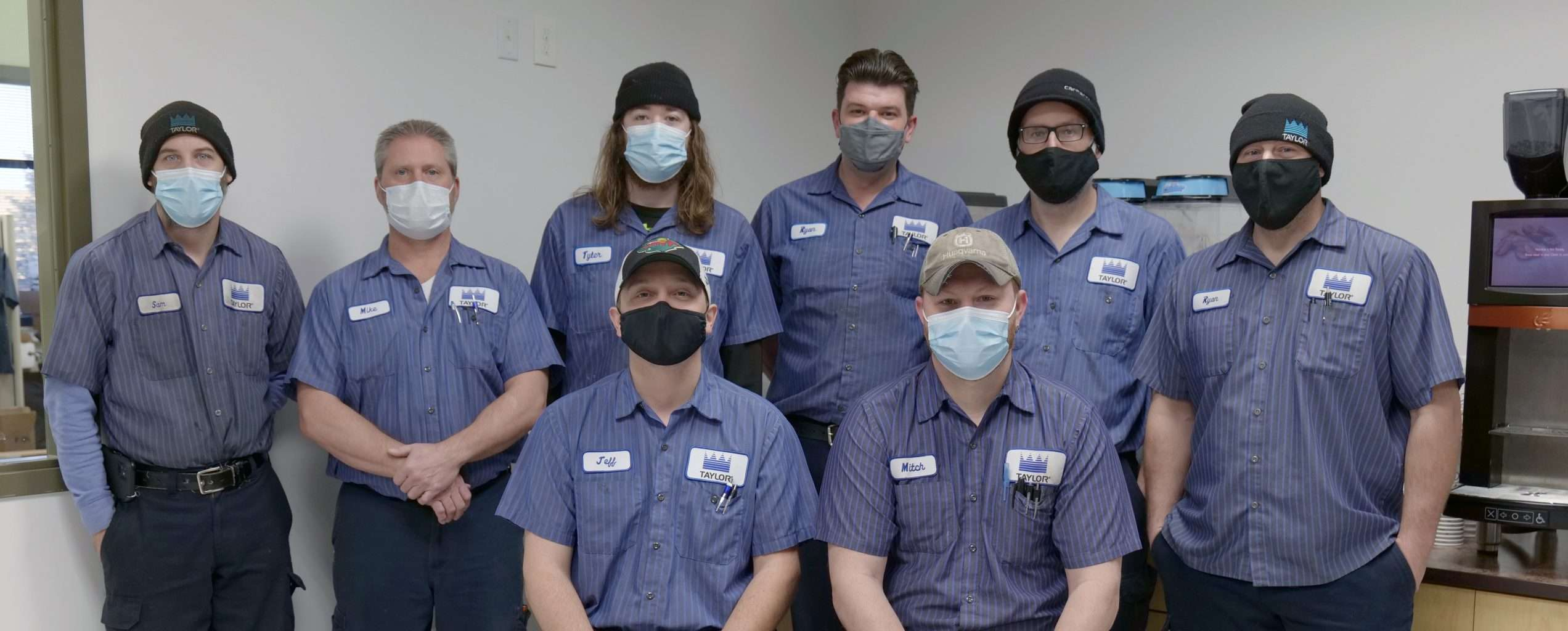 our service department technicians standing in our test kitchen