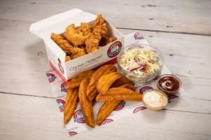 Broasted Chicken fingers with potato wedges coleslaw